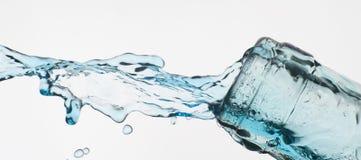 Bottle. And creative splashing water Royalty Free Stock Image