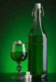 Bottle of absinthe. And glass with lump sugar stock images
