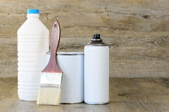 Bottle, aerosol, paint pot and brush Royalty Free Stock Photo