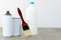 Bottle, aerosol, paint pot and brush Stock Photo