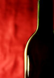 Bottle against a red background Royalty Free Stock Image