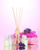 Bottle of air freshener, lavander and towels Royalty Free Stock Photos