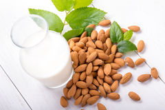 A bottle of almond milk with a pile of alond Royalty Free Stock Image