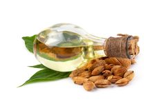 Bottle of almond oil and almonds  on white background Stock Photos