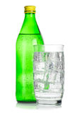 Bottle And Glass Of Iced Mineral Water Royalty Free Stock Image