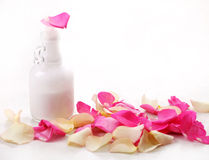 Bottle And Rose Petals Stock Images