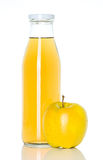 Bottle of apple juice with apple Royalty Free Stock Photos