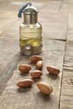 Bottle of argan oil and nuts Royalty Free Stock Photo