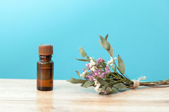 Bottle of aroma oil and wild flowers Royalty Free Stock Images