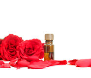 Bottle of aromatherapy oil and  roses Royalty Free Stock Image
