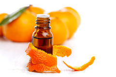 Bottle of aromatic essence and orange Stock Image