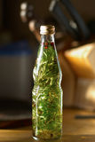 Bottle with aromatic oil Royalty Free Stock Photos