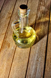 Bottle of aromatic olive oil and some olives. Stock Photo