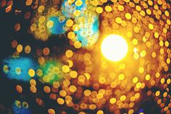 bottle background concert lights bokeh.Concept Festive Celebrations, Bottle of whiskey on bokeh at night street background with c royalty free stock image