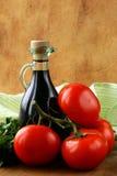 Bottle of balsamic vinegar. And fresh tomatoes stock photo
