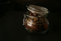 Bottle bank. Money in a glass jar royalty free stock image