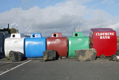 Bottle bank. Line of recycling containers stock images