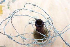Bottle barbed wire Royalty Free Stock Image