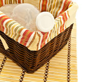 Bottle in basket Stock Photos