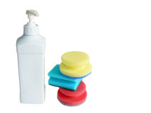 Bottle with batcher and kitchen sponges Stock Photos