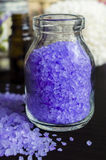 Bottle of bath salt with lavender extract Royalty Free Stock Photography