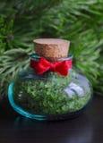 Bottle of bath salt with pine extract Stock Photos