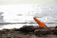 Bottle on beach. Sea and sky Royalty Free Stock Photography