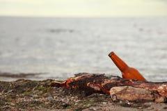 Bottle on beach. Sea and sky Stock Photos