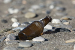 Bottle on the beach Stock Images