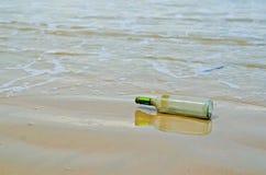 Bottle on beach Stock Photo