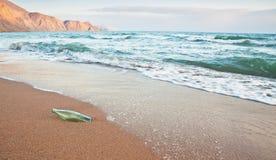 Bottle on the beach Stock Photos