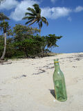 Bottle on a beach. An empty bottle on a beach waiting for a message Stock Image