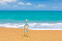 Bottle  on a beach Royalty Free Stock Photography
