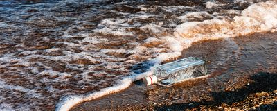 Bottle on the beach. With sos message royalty free stock image