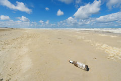 Bottle at the beach Stock Photography
