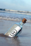 Bottle on the beach, @, e mail Stock Photo