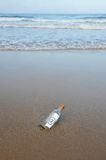 Bottle on the beach, @, e mail Royalty Free Stock Photos