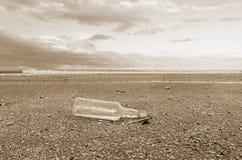 Bottle on the beach Stock Image