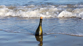Bottle on the beach with a message Royalty Free Stock Photos