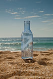 Bottle. In a beach. Ocean background Royalty Free Stock Images