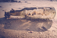 Bottle on the beach Royalty Free Stock Photography