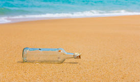 Bottle  on a beach Stock Photo