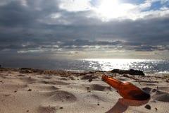 Bottle on beach Stock Image