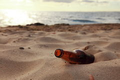 Bottle on beach Stock Photography