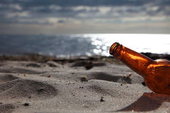 Bottle on beach Royalty Free Stock Photos