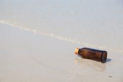 Bottle on the beach Stock Photo