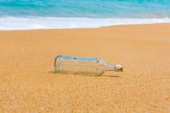 Bottle on a beach Royalty Free Stock Photos