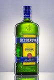 Bottle of Becherovka on gradient background. Stock Photos