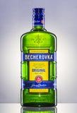 Bottle of Becherovka on gradient background. Royalty Free Stock Image