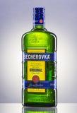 Bottle of Becherovka on gradient background. Stock Photo